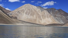 Pangong Lake in the Himalayas extends from India, Ladakh to Tibet Stock Footage