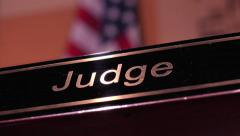 Judge name plate with American flag in background 4k Stock Footage