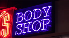 Neon Body shop sign advertising 4k Stock Footage