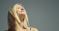Beautiful woman feeling the sun on her face Stock Footage