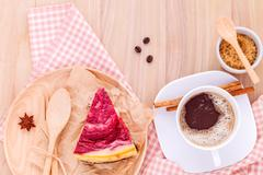Homemade raspberry cake with cup of coffee on wooden background. - stock photo