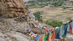 Buddhist prayer flags  in Tibetan monastery. Ladakh, Jammu & Kashmir, India Stock Footage