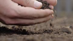 Hand palm on black ground closeup Stock Footage