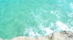 Turquoise water by the rocks Stock Footage