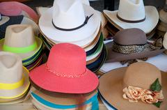 .Different types and models of hats numerous colors - stock photo