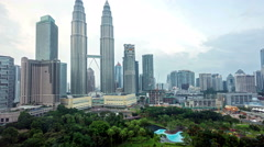 time lapse footage of cloudy hazy day at Kuala Lumpur City - stock footage