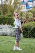 Little Girl with School Uniform in Green Park - stock photo