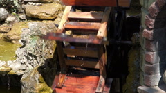 draws water watermill wheel - stock footage
