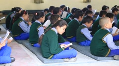 Tibetan children chant mantras in Buddhist school in Dharamsala, India Arkistovideo