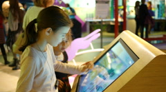 Cognitive museum for children - kids view and play with multimedia display Stock Footage