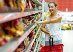 Woman shopping for cereal, bulk in a grocery supermarket Stock Photos