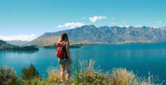 Hiker woman at Lake Wakatipu and Queenstown Stock Footage