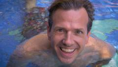 Close up portrait of an active adult man or father in a swimming pool Stock Footage