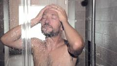 Man relaxing and washing out stress in shower Stock Footage