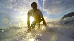 Three surfer take off Stock Footage