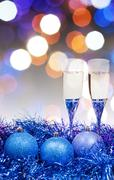 Stock Photo of glasses, blue Xmass balls on blurry background 10