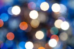 Blue blurred shimmering Christmas lights Stock Photos