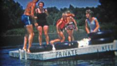 1956: Private swimming dock summer fun has kid ultra excited. Stock Footage