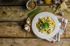 Tortellini with blue cheese sauce Stock Photos