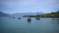 Boats floating on lake Thun Switzerland - stock footage