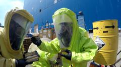 Firefighters with protective gear seal leak of hazardous materials Stock Photos