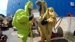 Stock Photo of Firefighters with protective gear seal leak of hazardous materials