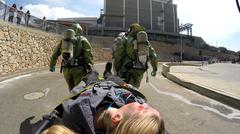 Stock Photo of Soldiers carry an injured person on stretcher after leak of toxic materials