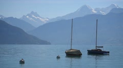Boats floating on lake Thun, Switzerland - stock footage