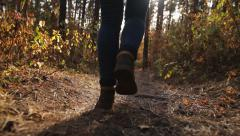 Feet. Boots. Young Woman Walking Along In The Autumn Forest - stock footage