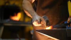 Blacksmith Forging a Sword  with Hammer in a Workshop Slow Motion Stock Footage