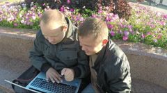 Two Happy Guys Looking At Laptop - stock footage