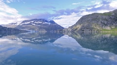 Reflection of mountains while entering Johns Hopkins Inlet in Glacier Bay Stock Footage