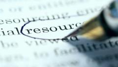 "Fountain pen circles the word ""resources"" in a printed document. Stock Footage"