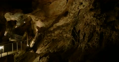 Camera tilt down from a stairs in a limestone cave Stock Footage