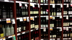 Motion of display red wine from the shelf with 4k resolution. - stock footage