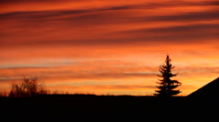 Sunset over field time-lapse - stock footage