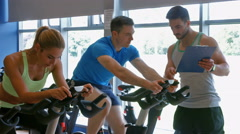 Spin class working out in the gym Stock Footage
