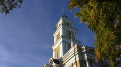Stock Video Footage of Church belfry and chestnut tree in autumn