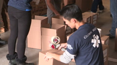 Workers packaging aid supplies for war zone homeless in Ukraine Stock Footage