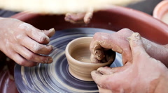 An experienced potter craft teaches boys Stock Footage