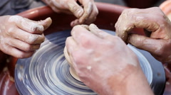 An experienced potter teaches craft boy , closeup and the product Stock Footage