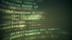 Programming code running down a computer screen terminal - stock footage