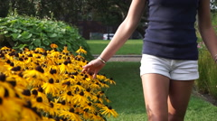 Millennial Woman Touching Sunflowers Stock Footage