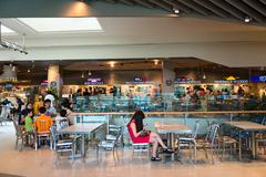 SINGAPORE - 01 JAN 2014: Customers dining in the food court of Orchard Road S Stock Photos