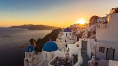 People watching sunset over beautiful town of Oia on Santorini Island Stock Footage