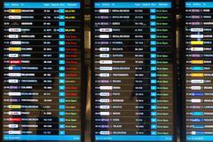 BANGKOK, THAILAND - 15 JULY 2014: Digital schedule board announcing flight de - stock photo