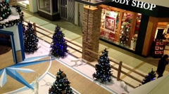 One side of shopping mall with Christmas treewas decorated of building. Stock Footage