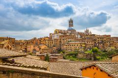 The Siena cityscape in southern Tuscany, Italy - stock photo