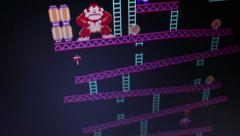HIgh angle wide shot 'Donkey Kong' retro arcade vintage videogame during game - stock footage