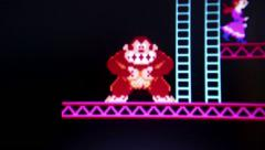 Medium Macro of 'Donkey Kong' gorilla character climbing blue ladders while c Stock Footage